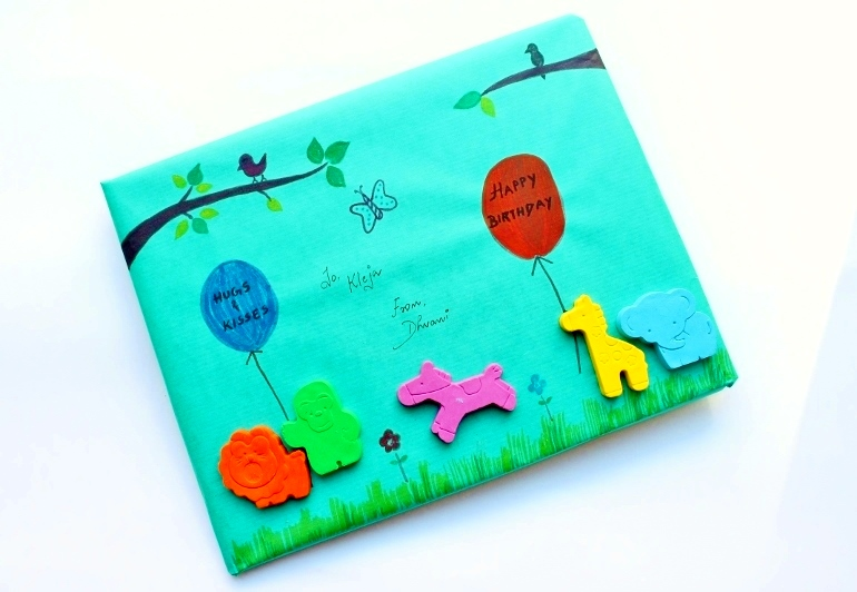 Here's a creative gift wrapping idea that could be a fun paper craft for kids